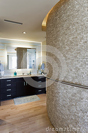 Bathroom With Curved Stone Wall And Cabinets Royalty Free Stock Photo - Image: 33907575