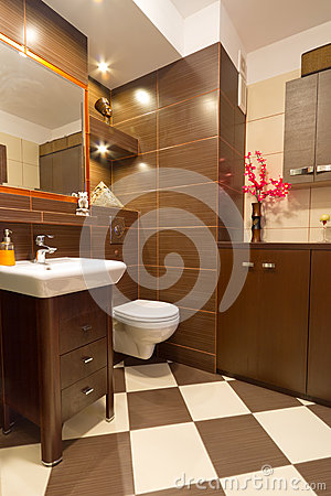 Bathroom interior with brown and beige tiles