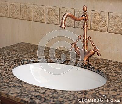 Bathroom washbasin and tap