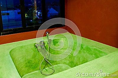 Bathtub in a room .