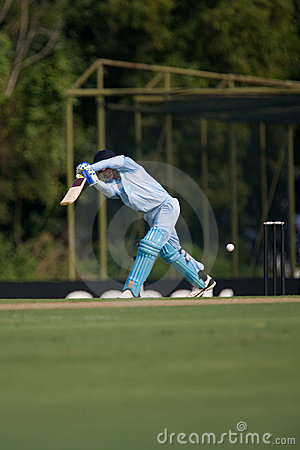 Batsman hitting cricket ball