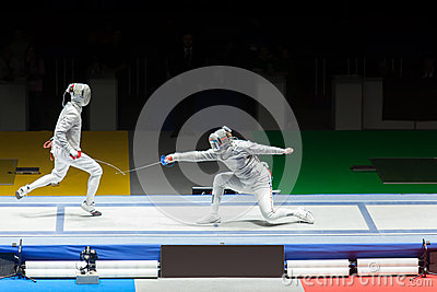 Battle on championship in fencing. Editorial Image