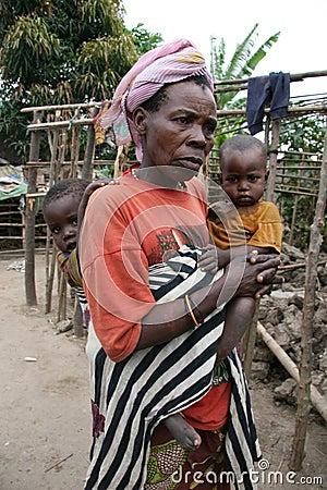 Batwa Pygmy woman and grandchildren in Burundi Editorial Stock Image