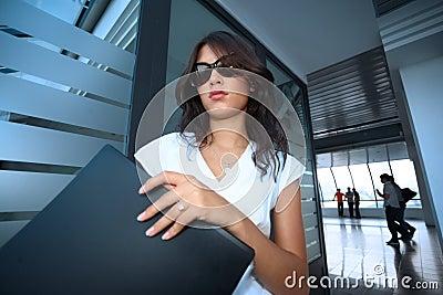Bautiful young businesswoman in futuristic interio