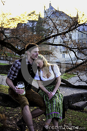 Free Bavarian Couple On A Tree Royalty Free Stock Image - 80573566