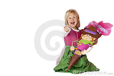 Bavarian girl on first school day showing thumb