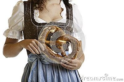 Bavarian girl  holding Oktoberfest Pretzel