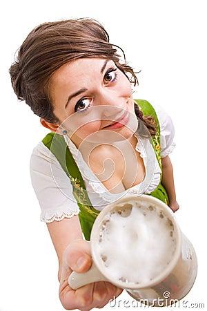 Bavarian girl offering beer