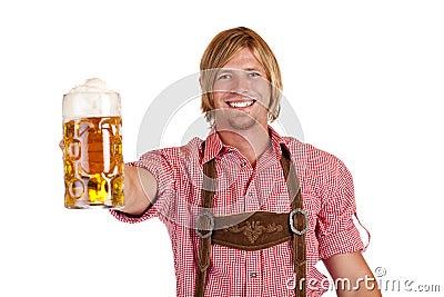 Bavarian man holds oktoberfest beer stein