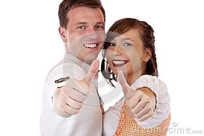 Bavarian man and woman showing thumbs up