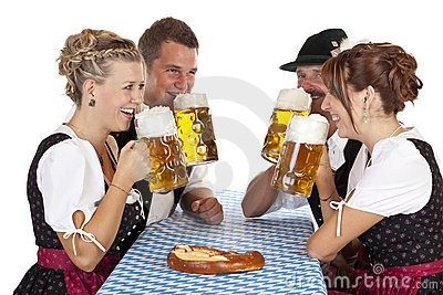 Bavarian men and women drinking Oktoberfest beer