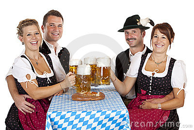 Bavarian men and women with Oktoberfest beer stein