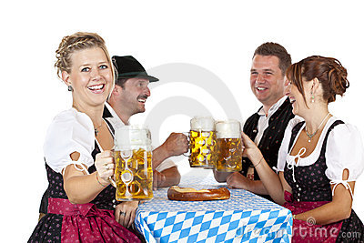 Bavarian men and women toast with Oktoberfest beer