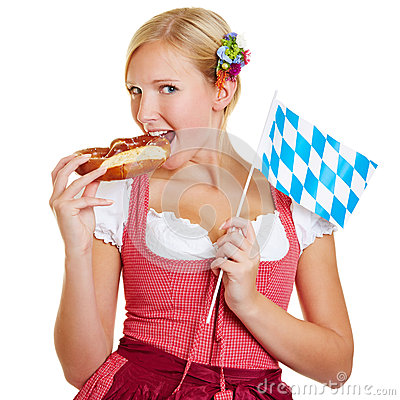 Bavarian woman eating a pretzel
