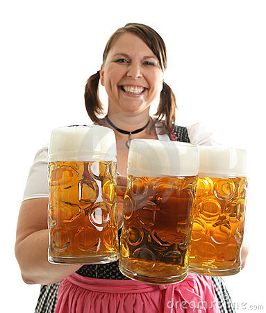 Bavarian Woman holding Oktoberfest beer in front