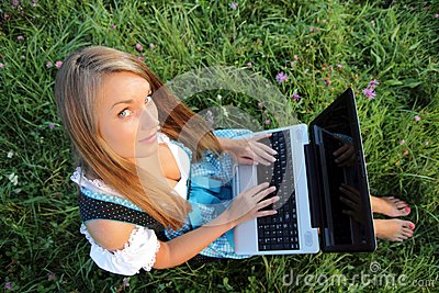 Bavarina Woman in Meadow with Laptop from above