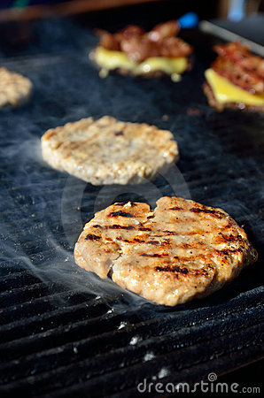 BBQ hamburger on the grill with smoke