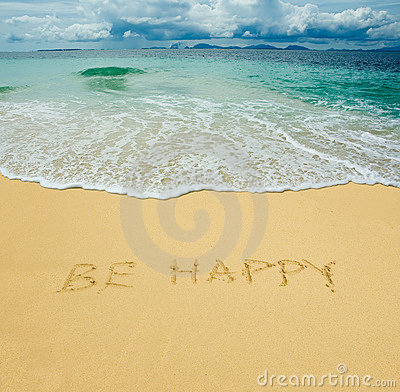 Be happy written in a sand