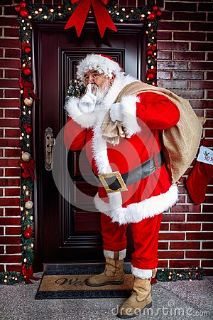 Free Be Quiet- Santa Claus Arrives With The Christmas Present Stock Photography - 105148392