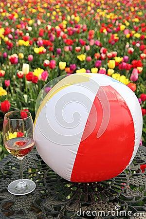 Beach ball, wine and flowers