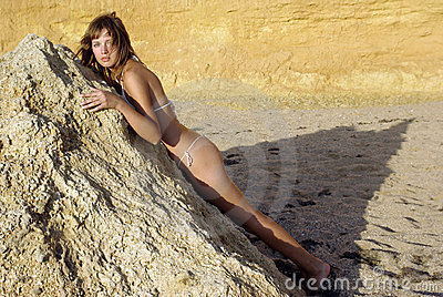 Beach beaty laying on a rock
