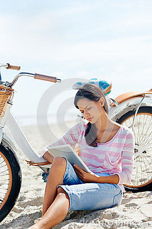 Beach bicycle tablet woman