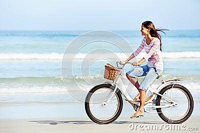 Beach bicycle woman