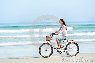 Beach bicycle woman
