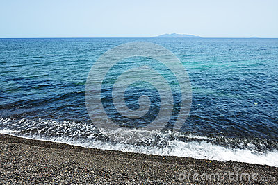The beach with black volcanic stones at Santorini island