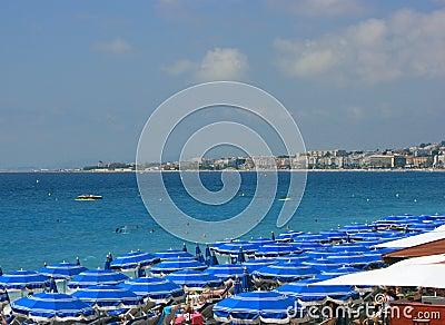 Beach with blue umbrellas 2