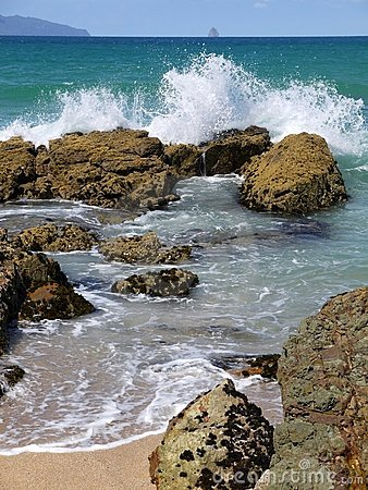 Beach: breaking waves rock