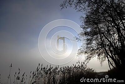 Beach, bridge and fog