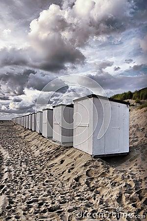 Beach cabins clouds