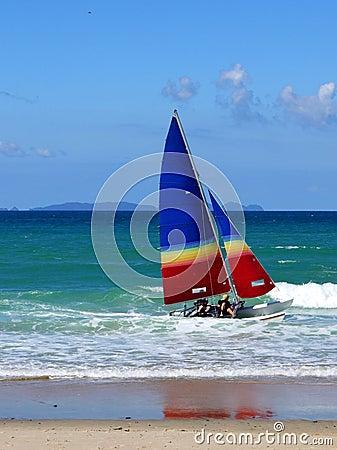 Beach: catamaran sailing in surf - close