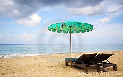 Beach chair and green umbrella