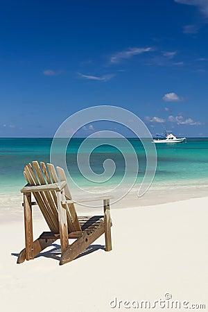 Beach chair on sand