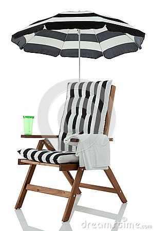 Beach chair with towel and drink