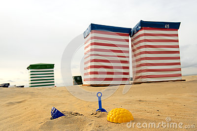 Beach chair and toys at the sea