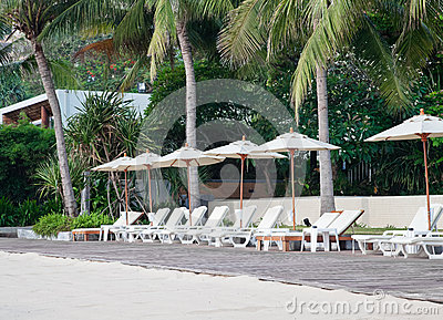 Beach chair and umbrella on tropical sand beach