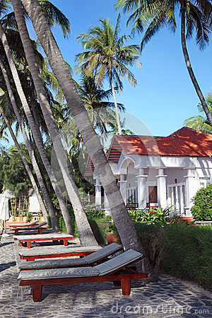 Beach chairs  and  luxury houses in tropical resor