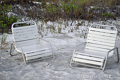 Beach chairs on sand