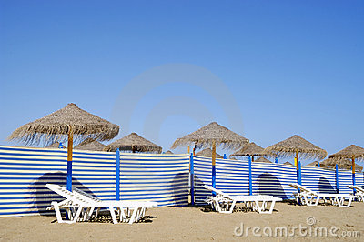 Beach chairs and sun shades