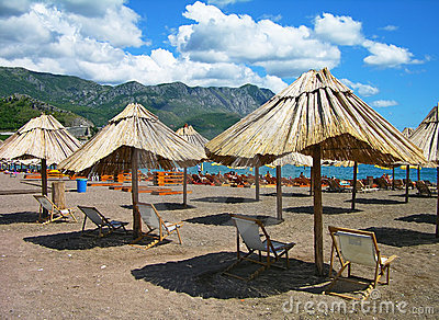 Beach with chairs and umbrellas