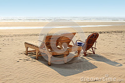 Beach chairs on the white sand beach