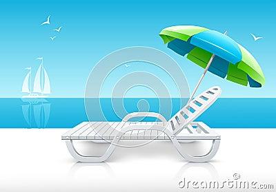 Beach chaise longue with umbrella on sea coast