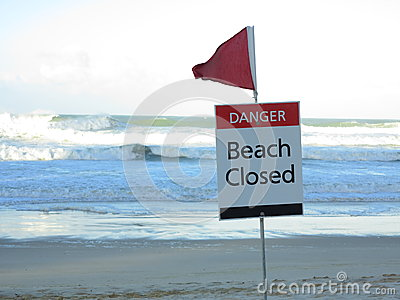 Beach closed warning sign