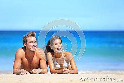 Beach couple looking