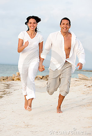Beach couple running