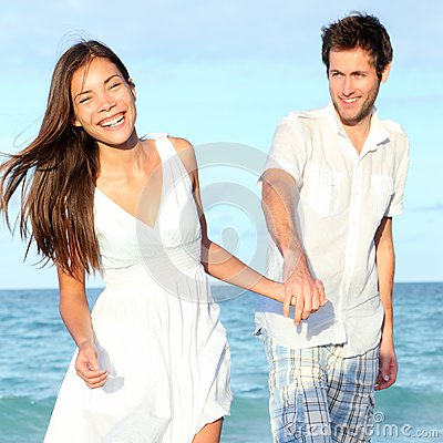 Beach couple walking happy