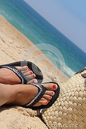 Beach and female feet